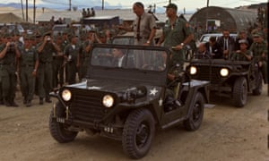 President Lyndon Johnson greets soldiers at Cam Ranh Bay, Vietnam, in October 1966. Standing in the jeep with Johnson is Gen William Westmoreland.