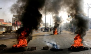 Sudanese protesters use burning tyres to erect a barricade on a street in Khartoum, demanding that the transitional military council hand over power to civilians.