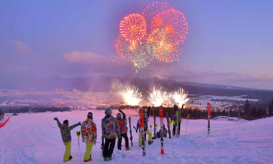 Skiers watch the fireworks during the opening ceremony in Samjiyon.
