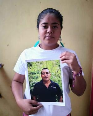 Gabriela Sorto holds a picture of her father, Porfirio Sorto Cedillo.