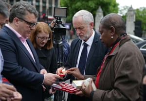 Labour leader Jeremy Corbyn and deputy leader Tom Watson light candles as they attend a vigil in Parliament Square.