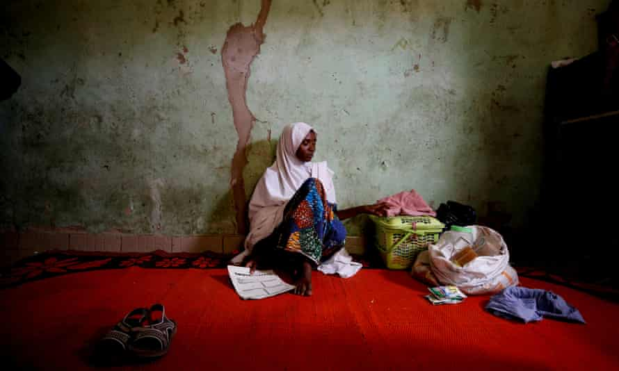 "Adama Mustapha, the mother of Salamutu, Fatima and Maryam, missing students of the Government Girls Science and Technical College in Dapchi, the northeastern state of Yobe, Nigeria, February 24, 2018. REUTERS/Afolabi Sotunde SEARCH ""DAPCHI PARENTS"" FOR THIS STORY. SEARCH ""WIDER IMAGE"" FOR ALL STORIES. TPX IMAGES OF THE DAY"