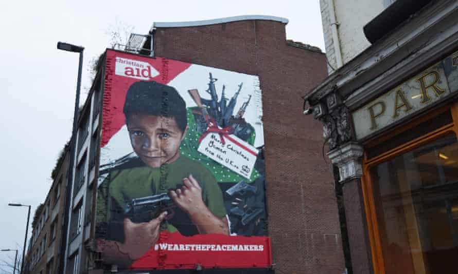 A mural in London depicts a Yemeni boy with a gun, part of a Christian Aid campaign against UK arms exports to Saudi Arabia.