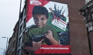 Artwork is seen on a London street depicting a young Yemeni boy holding a gun