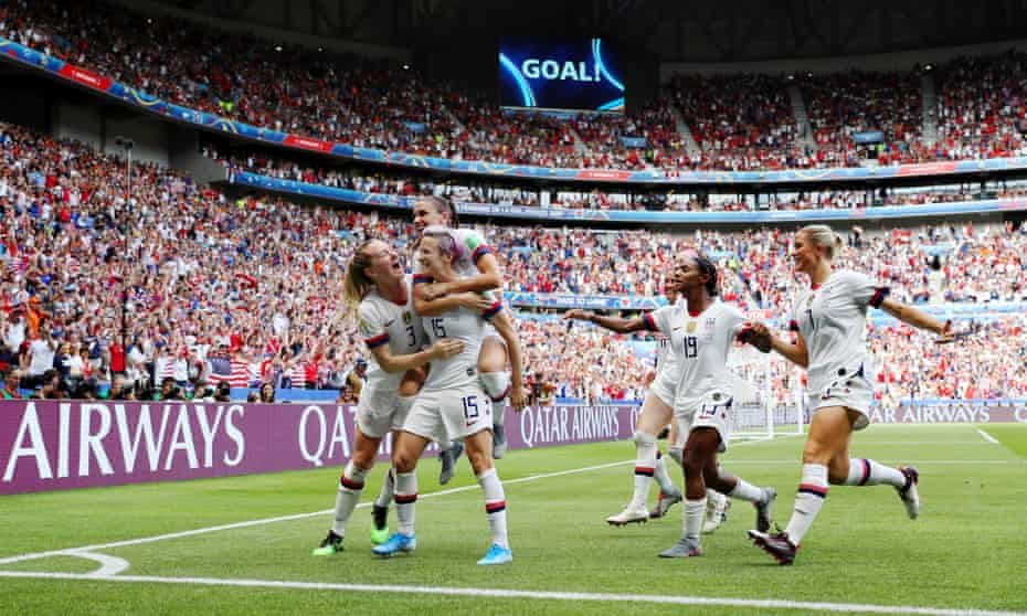 Rapinoe celebrates with teammates after scoring her team's first goal during the final against the Netherlands.