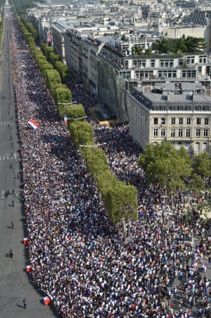 A huge crowd lines the Champs Élysées to welcome home the France team