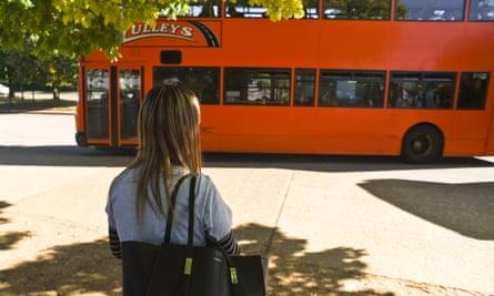 teenager looking at bus