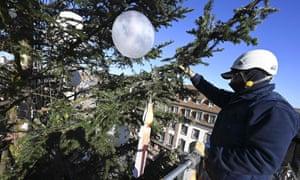 A worker installs lights on a huge Christmas tree in Strasbourg, France.