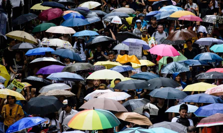 Chinese people and umbrellas in the rain