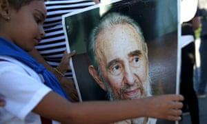 Marian Martin looks at a portrait of Fidel Castro in Revolution Square in Havana, Cuba, on 29 November 2016