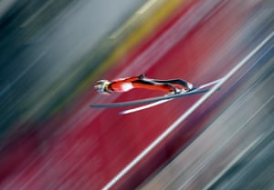 Michael Glasder of the US competes in the men's normal hill ski jumping trial.