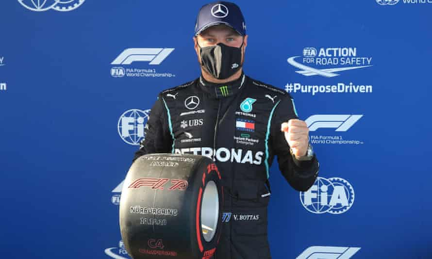 Valtteri Bottas poses with the trophy for taking pole for the Eifel F1 GP at the Nürburgring