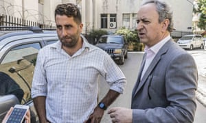 Ali al-Amin with his lawyer outside court in Beirut on Monday