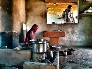 The village kitchen of Salawas in Rajasthan, northern India. As our guide sways gently to the sounds of Bollywood, his mother prepares food