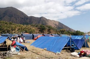 Makeshift tents are erected to be used as a temporary shelter for those affected by an earthquake in Sembalun, Lombok Island.
