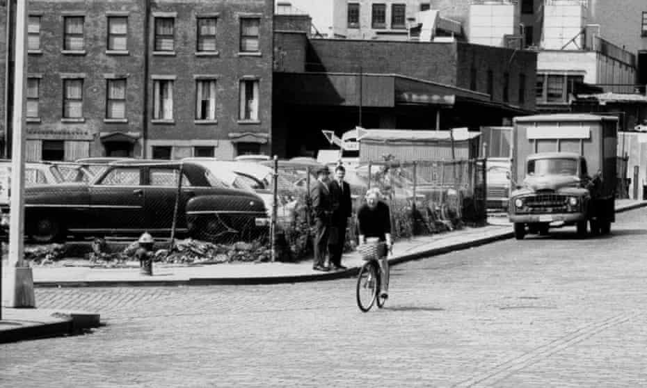 Jane Jacobs riding a bicycle in New York.