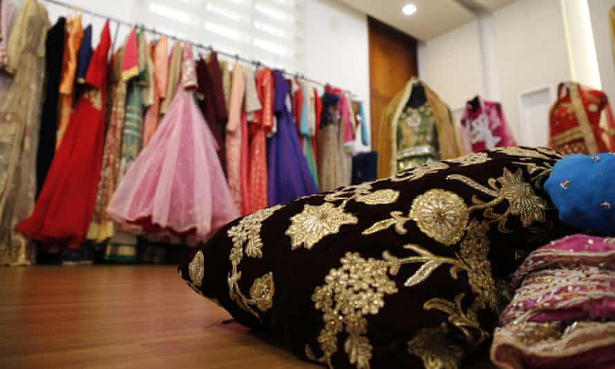 Secondhand clothes and wedding fabric are stored at Sabitha's home in Kannuar, Kerala. They will be given free of charge to women for their weddings.