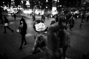 A face mask on a statue in Shibuya