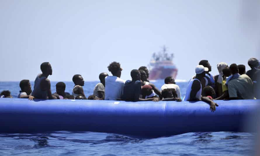 In this photo taken on 12 August 2019, migrants on a dinghy wait to be assisted by the Ocean Viking ship, operated by the NGOs SOS Méditerranée and Doctors Without Borders, in the Mediterranean Sea.