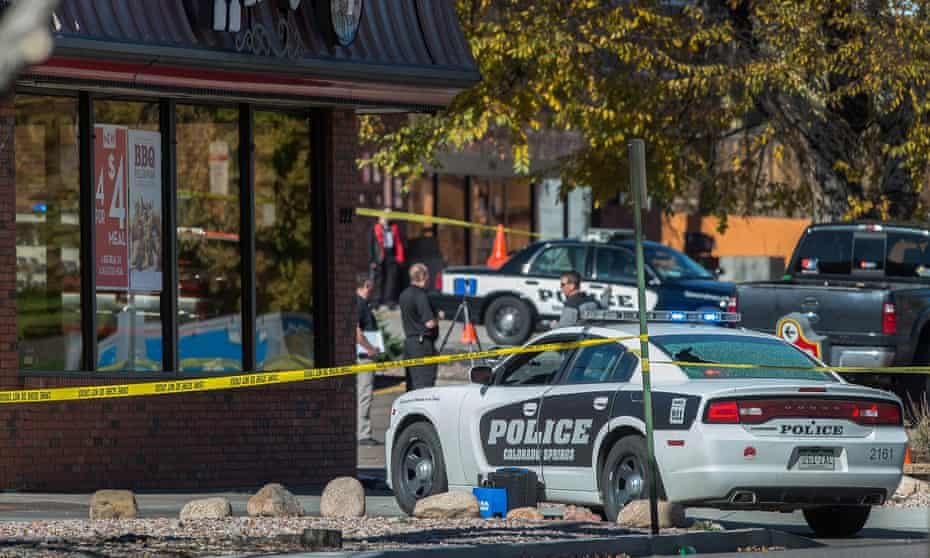 The rear window of a Colorado Springs police car is shattered after a shooting on Saturday.