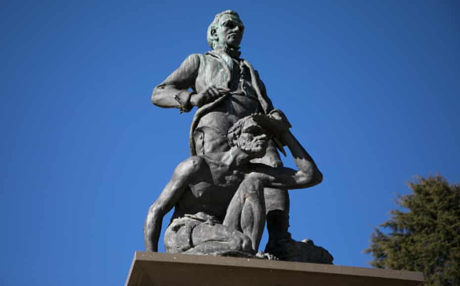 A statue in Bathurst depicting an Aboriginal man kneeling at the foot of the colonial explorer and surveyor George William Evans
