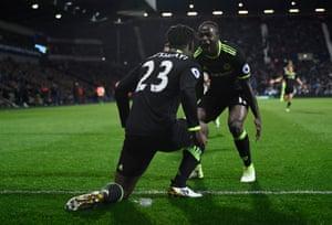 Batshuayi celebrates with Moses.