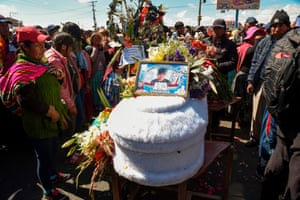 Mourners next to the coffin of one of eight supporters of Bolivia's ex-President Evo Morales.