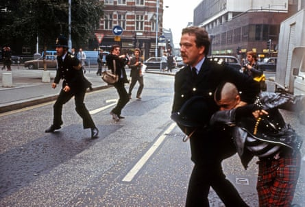 Countering the police narrative: a young punk feeling the strong arm of the law.