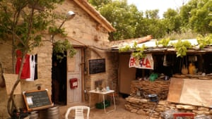 The outside kitchen with blackboards hanging