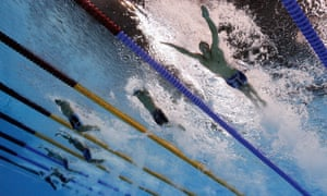 Michael Phelps of the United States, Zhuhao Li of China and Joseph Schooling of Singapore compete in the men's 100m butterfly final.