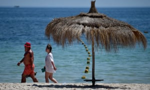 Tourists continue with their holidays at Marhaba beach near where 38 people were killed in Sousse, Tunisia.