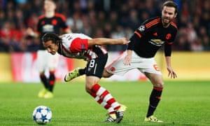 Juan Mata attempts a challenge on Andres Guardado.