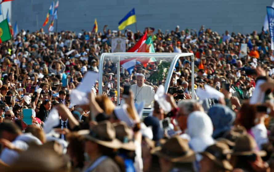 Devotees surround the popemobile as Francis heads to the Shrine of Our Lady of Fátima.