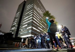 Members of the media gathered in front of the building of the Tokyo District Public Prosecutors Office in Tokyo, Japan.