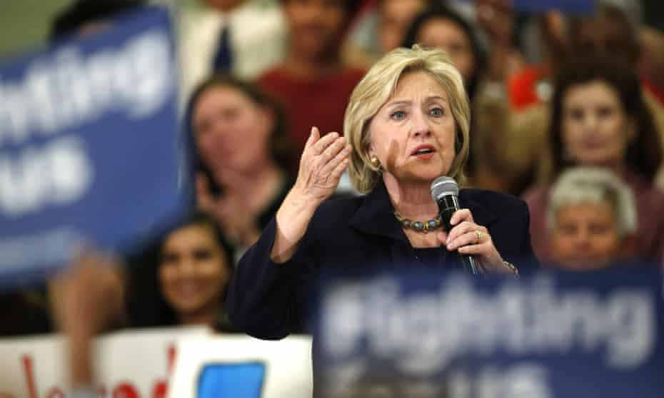 Hillary Clinton speaks during a rally in Denver. The Democrat has said the words 'illegal immigrants' are 'a poor choice of words'.
