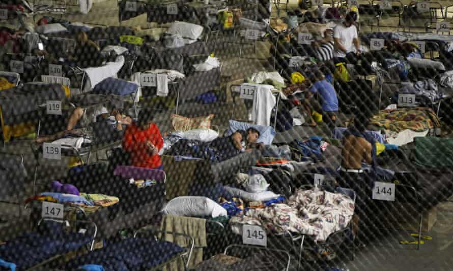Evacuees from the Fort McMurray wildfires rest on a hockey rink at the evacuation center in Lac la Biche, Alberta.