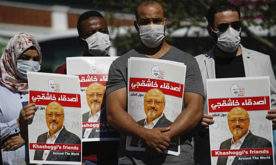 People hold posters of murdered Jamal Khashoggi near the Saudi Arabia consulate in Istanbul, marking the two-year anniversary of his death.
