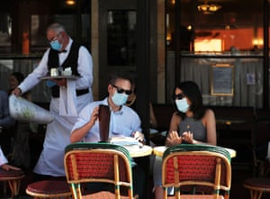 A couple prepare to order at Cafe de Flore in Paris