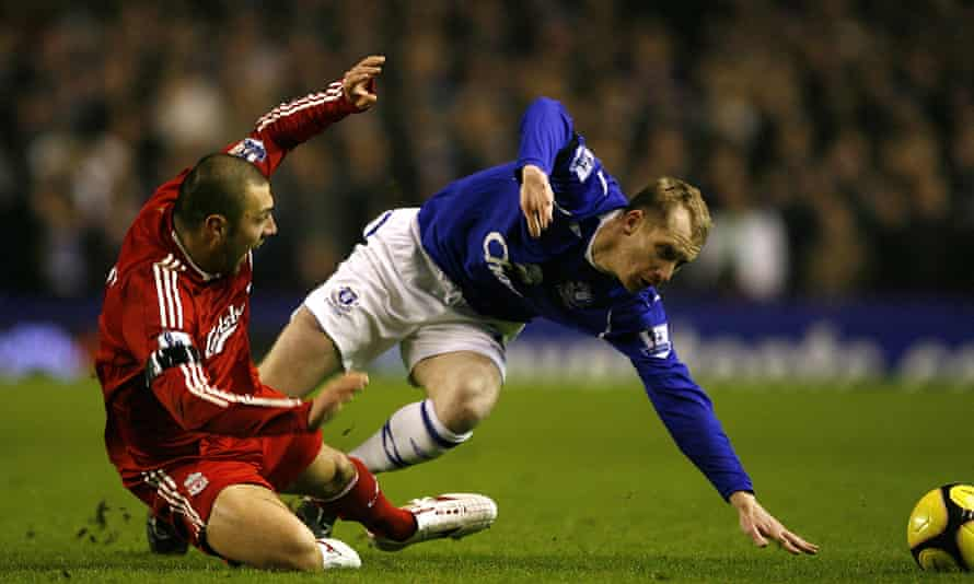 Andrea Dossena tangles with Everton's Tony Hibbert during an FA Cup derby at Goodison Park in February 2009.