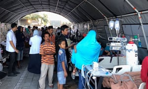 Residents seek medical attention at a makeshift hospital in Mataram.
