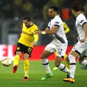 Dortmund's Gonzalo Castro under pressure from Tottenham's Nacer Chadli.
