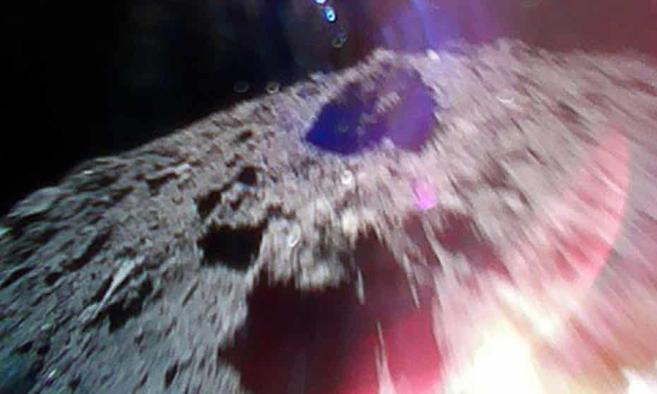 A handout photo taken by Hayabusa2's Rover-1A shows the surface of asteroid Ryugu.