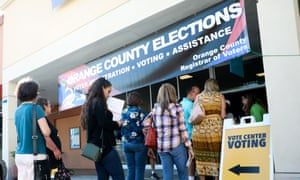 Voters line up to cast ballots in the 2018 midterm elections at a polling station in Huntington Beach, California.