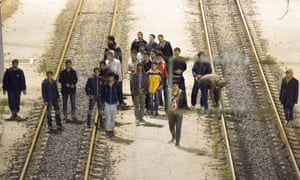Migrants walking down the railway track to get to the Channel tunnel