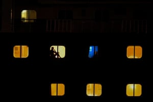 Panama City, Panama Passengers on Holland America's Zaandam cruise ship are seen through the vessels windows as it navigates through the Panama Canal. Those aboard the virus-stricken liner stranded have been told the company was still searching for a port that will allow them to disembark