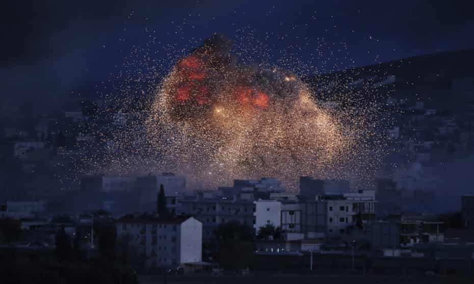 Thick smoke and flames rise after an airstrike in Kobani