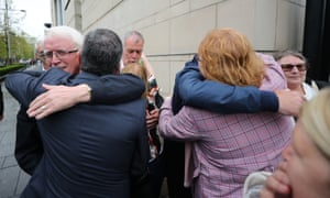 Relatives of those who died on Bloody Sunday and in Ballymurphy embrace outside court in Belfast
