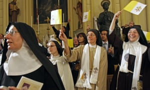 Cloistered nuns wave Vatican flags before Pope Benedict XVI's visit to Jerusalem.