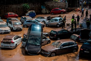 Athens, Greece: Emergency workers assess a car park that was hit by a flash flood