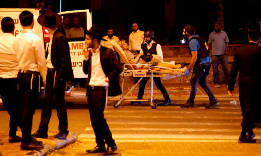 A woman is loaded into an ambulance by Israeli emergency personnel after a rocket attack in the southern town of Ashdod.